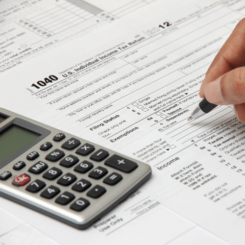 Person filling out income tax paperwork