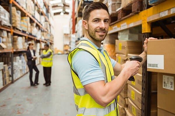 Hardware store employee stamping boxes