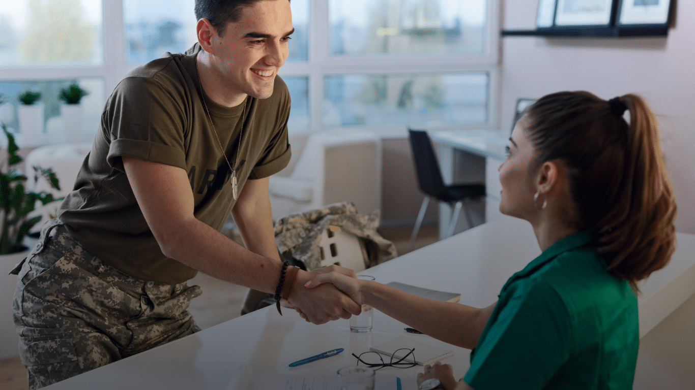 Veteran shaking hands with a woman