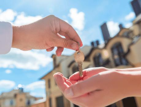 Landlord handing off keys to tenant