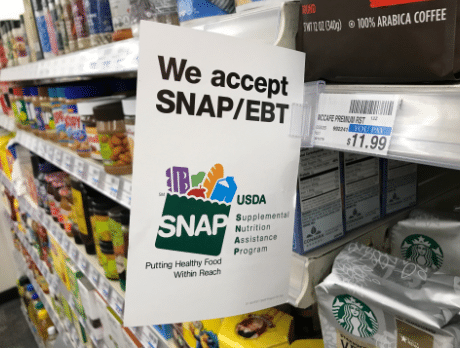 A sign in the grocery story of the SNAP/EBT program