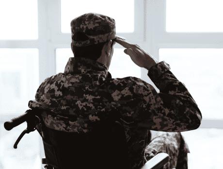 Veteran in a wheelchair saluting